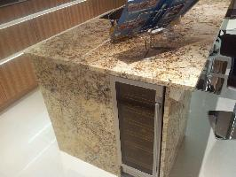 wine cooler set in solaris granite island end panel